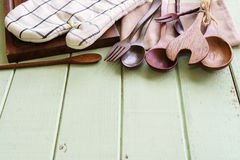 Kitchen cooking utensils on rustic wooden background Royalty Free Stock Images