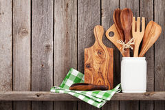 Kitchen cooking utensils on shelf Royalty Free Stock Images