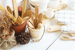 Kitchen cooking utensils on a shelf Stock Image