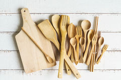 Kitchen cooking utensils on a shelf. With white rustic wooden background Stock Photography