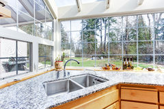 Kitchen corner with sink and granite top Royalty Free Stock Images