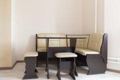Kitchen corner sofa and table in interior Stock Photo