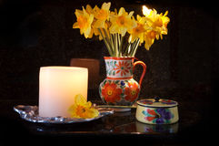 Kitchen Counter Display. Beautiful dafodils in a decorative vase on the kitchen counter royalty free stock image