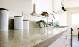 Kitchen Counter. Kitchen Granite Counter, plant, wine glasses, wine rack Royalty Free Stock Photo