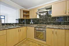 Kitchen counter with granite worktop Stock Images