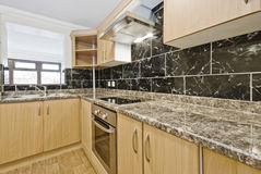 Kitchen counter with granite worktop. Modern kitchen with granite worktop and serving window royalty free stock photography