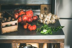 Kitchen counter with ingredients for cooking tomato sauce or pasta stock images