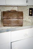 Kitchen counter with a rusted old lunch box Royalty Free Stock Photography