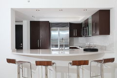 Kitchen with counter and stools Stock Photos