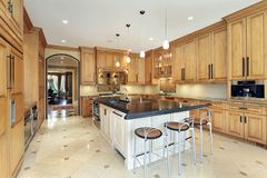 Kitchen with counter top island Stock Photography