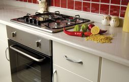 Kitchen countertop. Stove and oven in a modern kitchen Stock Photography
