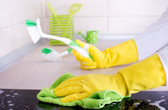 Kitchen countertop cleaning Royalty Free Stock Photography