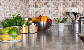 Kitchen countertop with food ingredients and herbs stock photography