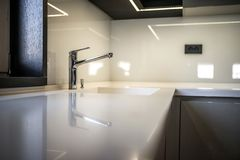 Kitchen countertop in modern apartment Royalty Free Stock Image