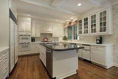 Kitchen with cream colored cabinetry Stock Photography
