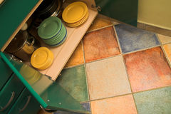 Kitchen cupboard dishes. Open kitchen cupboard with dishes and plates. Colorful and lovely kitchen interior Stock Photos