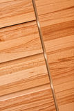 Kitchen cupboards. Close of fronts of drawers and cupboards in modern wooden kitchen cabinets royalty free stock photo