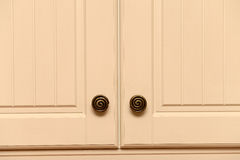 Kitchen cupboards. A close up of kitchen cupboard doors and knobs Royalty Free Stock Photo