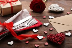 Kitchen cutlery with napkin. And hearts on wooden table Stock Photography