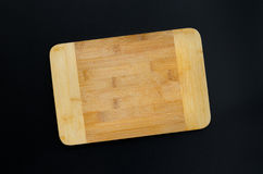 Kitchen cutting board. On black background. Overhead food shots. Copy space background Stock Photo