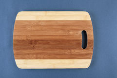 Kitchen cutting board  on a blue Stock Photography
