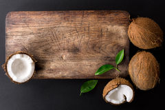 Kitchen cutting board and coconut with green leaves Stock Photography