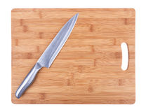 Kitchen cutting board and a large kitchen knife. Stock Photography
