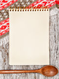Kitchen cutting board and paper notebook Royalty Free Stock Photos