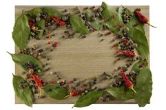 Kitchen cutting board, scattered spices in the form of a frame stock photography