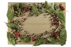 Kitchen cutting board, scattered spices in the form of a frame. stock images