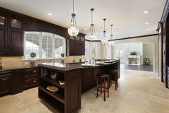 Kitchen with dark wood cabinetry Royalty Free Stock Image
