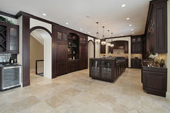 Kitchen with dark wood cabinetry Royalty Free Stock Photography
