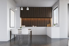 Kitchen with dark wood furniture and poster Stock Photo