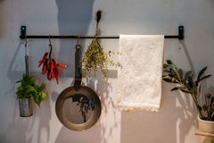 Kitchen decoration with hanging pots and pans Stock Images