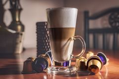 Kitchen decorations, a glass of striped coffee Stock Image