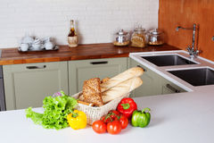 Kitchen design light fresh vegetables, bread basket, lettuce, peppers, tomatoes, shopping, cooking two sinks with Royalty Free Stock Images