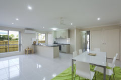 Kitchen and dining area. Modern kitchen and dining area in Australian townhouse Stock Photos