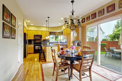 Kitchen with dining area and exit to backyard Royalty Free Stock Photography