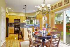 Kitchen with dining area and exit to backyard Royalty Free Stock Images