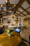 Kitchen With Dining Area In Foreground Royalty Free Stock Image