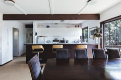 Kitchen and dining area of older style retro funky beach house Stock Photos