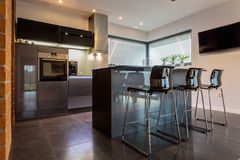Kitchen with dining room. New luxury kitchen connected with dining room Stock Images