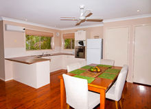Kitchen and Dining Rooms. View of an open kitchen and dining area Stock Photos