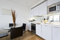 Kitchen with dining table. Modern bright kitchen with dining table for four Stock Images