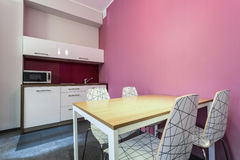 Kitchen and dinning room. With rose wall Royalty Free Stock Images