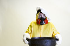 Kitchen disaster, hazmat suit and chef hat Royalty Free Stock Photos