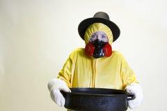 Kitchen disaster, hazmat suit and pilgrim hat Royalty Free Stock Photos