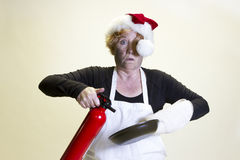 Kitchen disaster, santa hat and fire extinguisher Stock Images