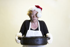 Kitchen disaster, santa hat and roasting pan Royalty Free Stock Images