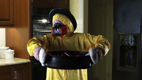 Kitchen Disasters, Woman with HazMat suit and Pilgrim Hat stock footage